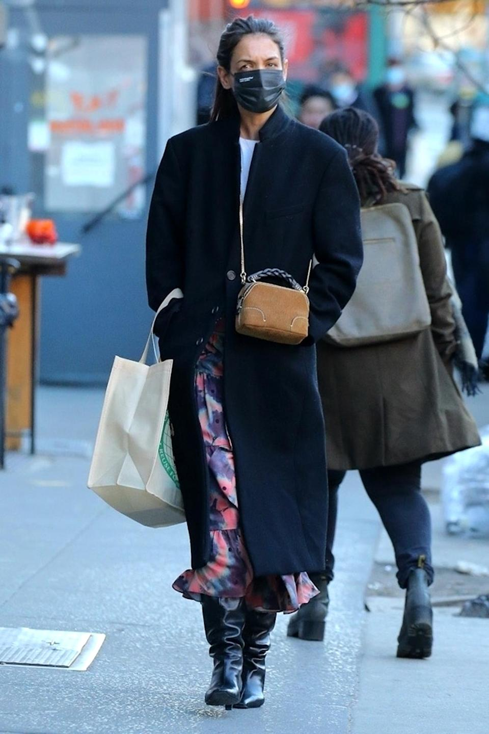 <p>Katie Holmes was spotted out and about and wearing a face mask in New York City.</p>