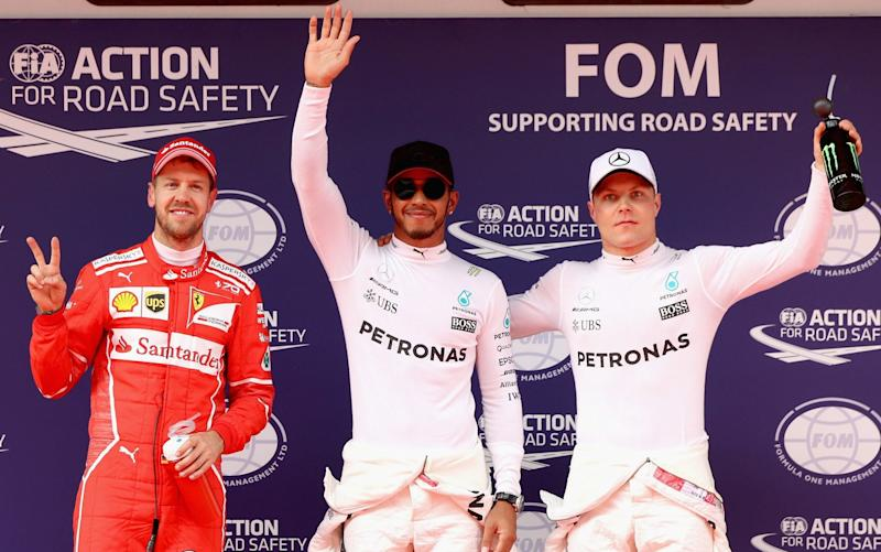 Sebastian Vettel, Lewis Hamilton and Valtteri Bottas - Credit: Getty Images
