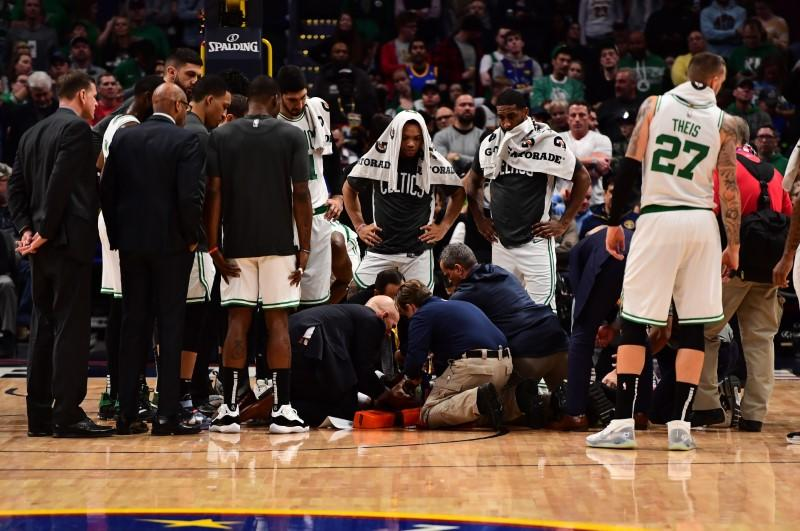 Walker leaves game on stretcher after collision with teammate