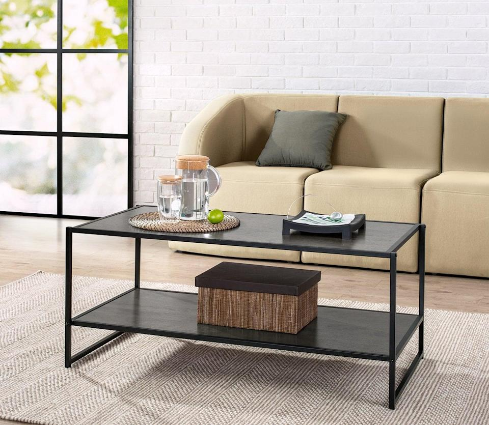 <p>If you're looking for a dark finish, try this <span>Zinus Modern Studio Collection Deluxe Coffee Table</span> ($45). It has an industrial quality that makes it great for an office space.</p>