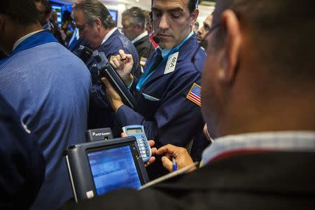 Traders work on the floor of the New York Stock Exchange shortly after the start of trading