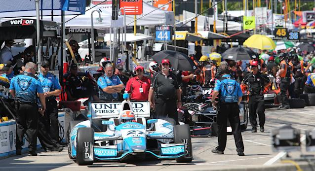 Driver James Hinchcliffe leaves the pit stall during a practice session for the IndyCar Detroit Grand Prix auto race on Belle Isle in Detroit, Friday, May 30, 2014. (AP Photo/Dave Frechette)