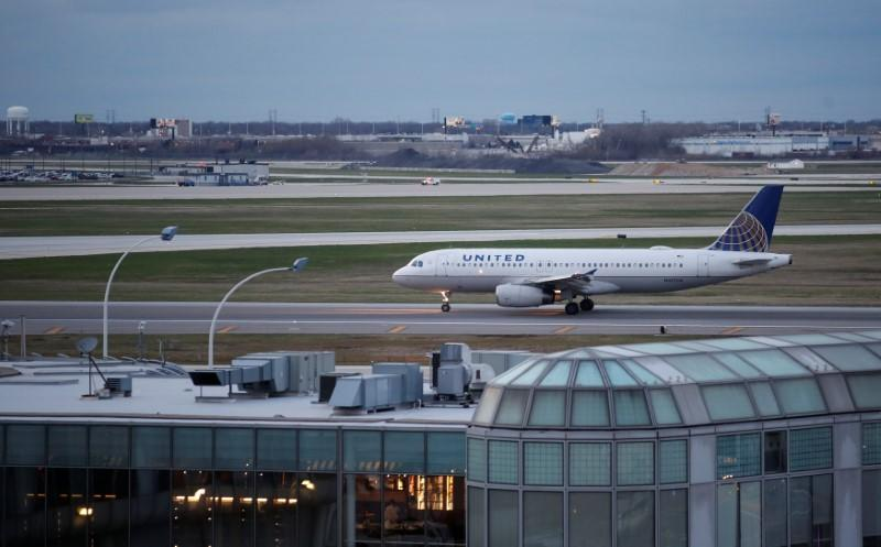 A United Airline aircraft lands at O'Hare International Airport in Chicago
