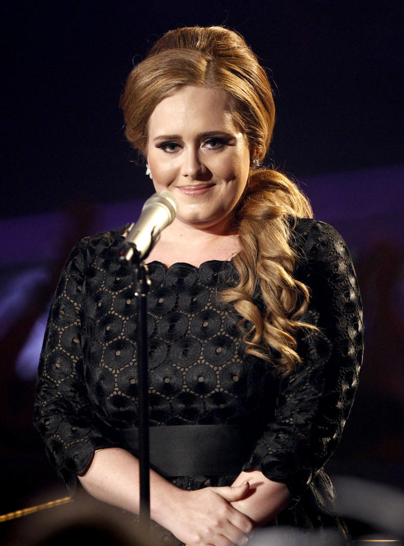 "FILE - In this Sunday Aug. 28, 2011 file photo  Adele performs at the MTV Video Music Awards  in Los Angeles. U.S. album sales rose more than 3 percent last year for the first gain since 2004 - a sign that rising digital sales are finally stemming the decade-long decline of compact discs. The uptick to 458 million album sales was helped by the hugely popular sophomore album ""21"" from British singer Adele, which sold 5.8 million, according to Nielsen SoundScan.  (AP Photo/Matt Sayles)"