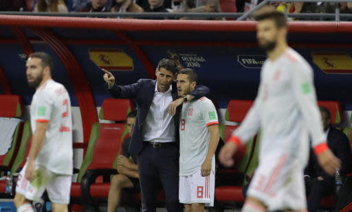 Spain head coach Fernando Hierro gestures as he speaks to his player Spain's Koke during the group B match between Iran and Spain at the 2018 soccer World Cup in the Kazan Arena in Kazan, Russia, Wednesday, June 20, 2018. (AP Photo/Sergei Grits)