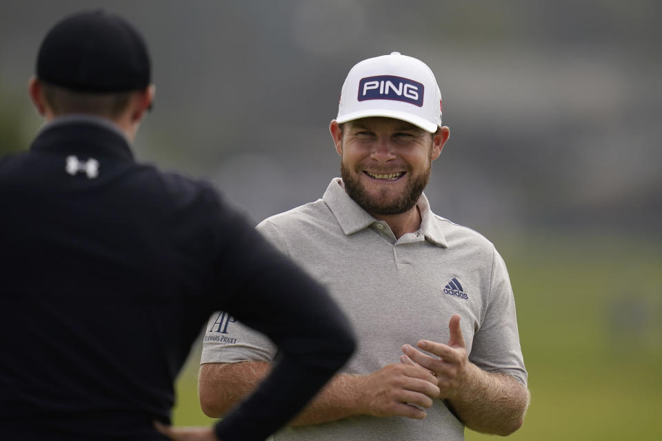 Tyrrell Hatton, right, laughs with Matt Fitzpatrick, of England, on the first green during the first round of the U.S. Open Golf Championship, Thursday, June 17, 2021, at Torrey Pines Golf Course in San Diego. (AP Photo/Gregory Bull)