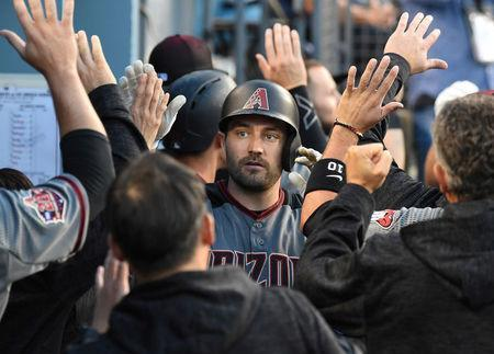 May 8, 2018; Los Angeles, CA, USA; Arizona Diamondbacks center fielder A.J. Pollock (11) is greeted in the dugout after hitting a two run home run off of Los Angeles Dodgers starting pitcher Rich Hill (44) in the first inning of the game at Dodger Stadium. Mandatory Credit: Jayne Kamin-Oncea-USA TODAY Sports