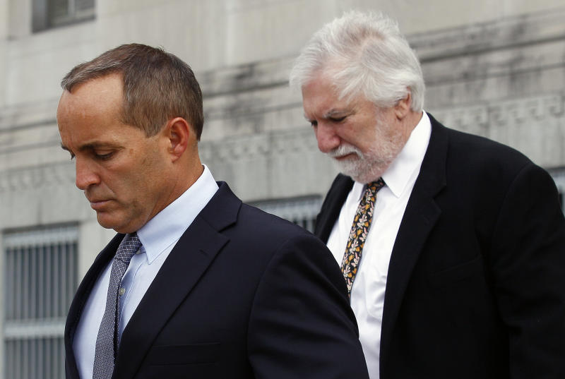 Andrew Young, former aide to former U.S. Sen. and presidential candidate John Edwards, leaves federal court with attorney David Geneson, right, in Greensboro, N.C., Monday, April 23, 2012. Prosecutors and defense lawyers began making their case to jurors on whether the former presidential candidate violated federal campaign finance laws. (AP Photo/Gerry Broome)
