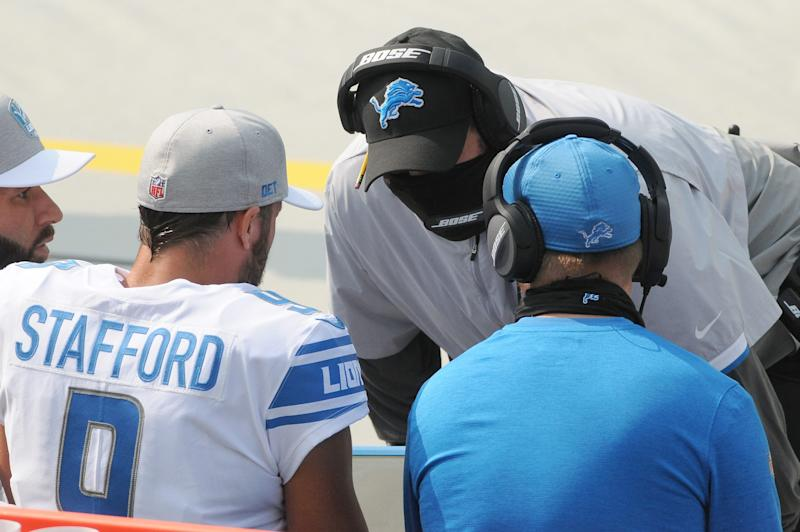 Detroit Lions head coach Matt Patricia talks with quarterback Matthew Stafford after they scored their second touchdown in the first quarter against the Green Bay Packers at Lambeau Field, Sept. 20, 2020.
