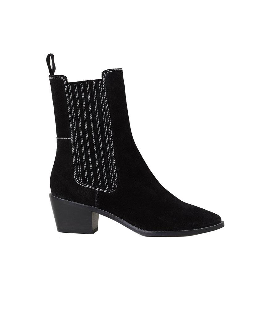 """<p>Ease into the Western boot trend with this stylish black suede pair. <br><a href=""""https://fave.co/2ztJD6M"""" rel=""""nofollow noopener"""" target=""""_blank"""" data-ylk=""""slk:Shop it:"""" class=""""link rapid-noclick-resp"""">Shop it:</a> H&M Suede Boots, $80, <a href=""""https://www2.hm.com/en_us/productpage.0674101001.html?utm_source=Rakuten&utm_medium=Affiliate&utm_campaign=2116208_Skimlinks.com&utm_content=10&utm_term=US_Network&ranMID=43148&ranEAID=TnL5HPStwNw&ranSiteID=TnL5HPStwNw-3VFHERTneZcqv9Co3ddhAQ"""" rel=""""nofollow noopener"""" target=""""_blank"""" data-ylk=""""slk:hm.com"""" class=""""link rapid-noclick-resp"""">hm.com</a> </p>"""