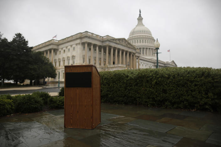 An empty speaker's lectern is seen in the rain outside the U.S. Capitol in Washington, October 10, 2013.  U.S. House of Representatives Republicans are weighing a short-term debt limit increase with no added policy changes, such as deficit-reduction requirements, according to a source with knowledge of the discussions. REUTERS/Jonathan Ernst (UNITED STATES - Tags: POLITICS BUSINESS)