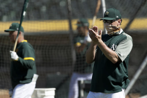Oakland Athletics manager Bob Melvin applauds a player during a baseball practice on Thursday, July 9, 2020, in Oakland, Calif. (AP Photo/Ben Margot)