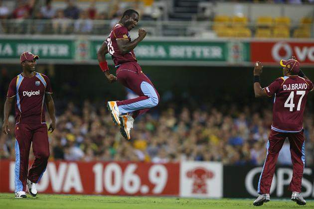 BRISBANE, AUSTRALIA - FEBRUARY 13:  Darren Sammy of West Indies celebrates after dismissing Aaron Finch of Australia during the International Twenty20 match between Australia and the West Indies at The Gabba on February 13, 2013 in Brisbane, Australia.  (Photo by Chris Hyde/Getty Images)