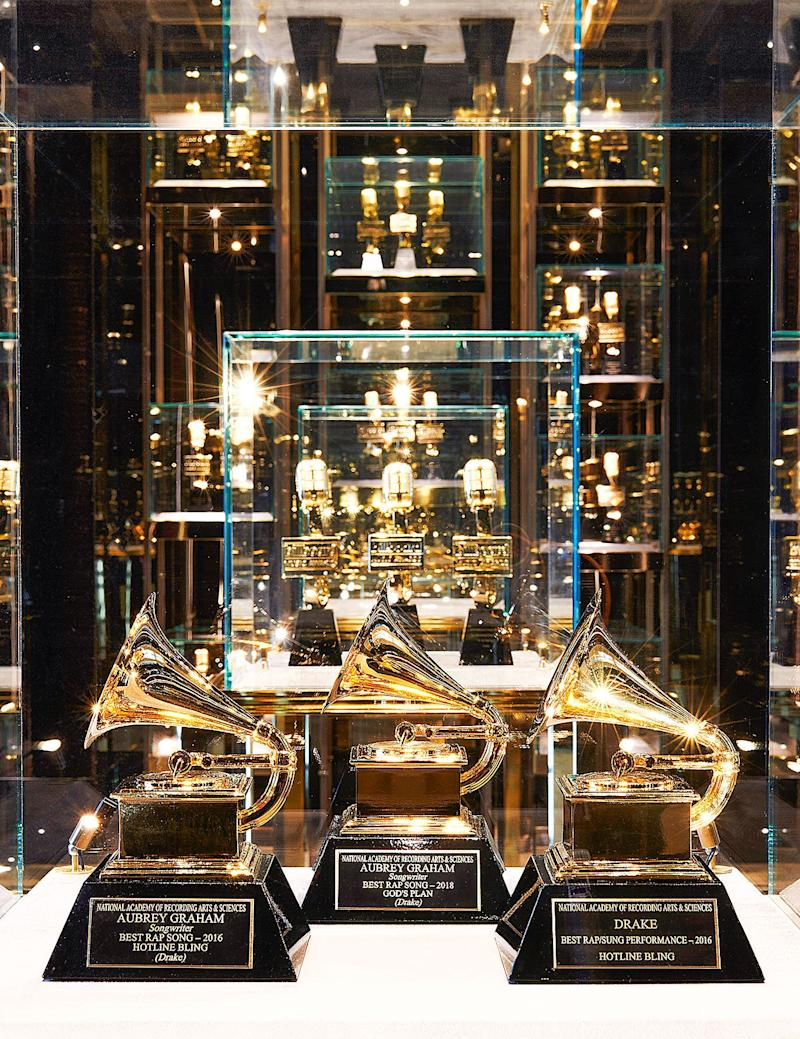 Drake's Grammys are displayed in his awards room.