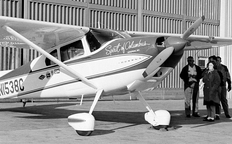 FILE - This photo made March 19, 1964 in Columbus, Ohio, shows Jerrie Mock, beginning her around-the-world flight. Mock was meeting her crew for a final check of the Spirit of Columbus. Fifty years ago Mock became the first woman to make a solo flight around the world. (AP Photo/Gene Smith)