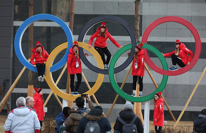 Swiss athletes pose inside the Olympic rings in Pyeongchang, South Korea, on Feb. 8, 2018. (Steve Russell via Getty Images)