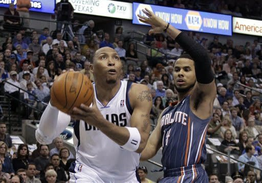 Dallas Mavericks forward Shawn Marion, left, drives past Charlotte Bobcats' D.J. Augustin in the first half of an NBA basketball game on Thursday, March 15, 2012, in Dallas. (AP Photo/Tony Gutierrez)