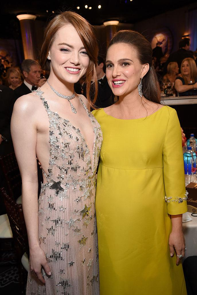Woman power! Natalie Portman and Emma Stone are all smiles. (Photo: Getty Images)