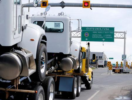 A truck heads towards the United States at the Lacolle border crossing in Lacolle, Quebec, Canada