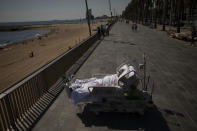 """Francisco España, 60, looks at the Mediterranean sea from a promenade next to the """"Hospital del Mar"""" in Barcelona, Spain, Sept. 4, 2020. Francisco spent 52 days in the ICU of the hospital due to an infection of Coronavirus and he has being allowed by his doctors on this day to spend almost ten minutes at the seaside as part of a therapy to recover from the ICU. The image was part of a series by Associated Press photographer Emilio Morenatti that won the 2021 Pulitzer Prize for feature photography. (AP Photo/Emilio Morenatti)"""