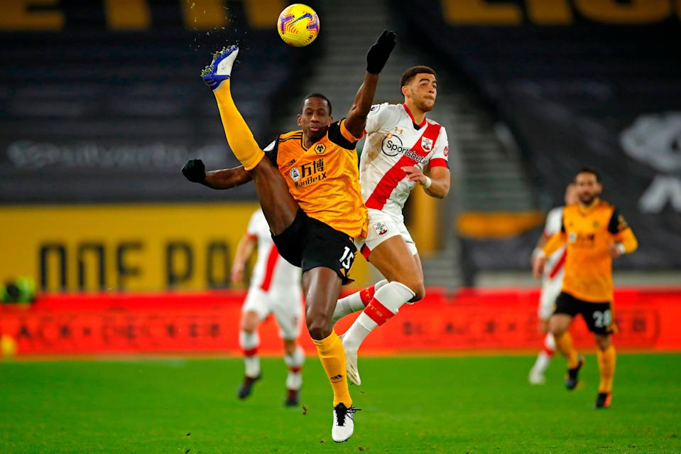 <p>Willy Boly challenges for the ball</p> (Getty)