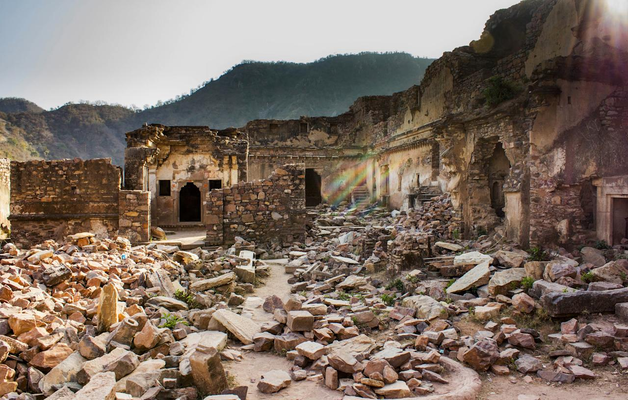 "Located just 100 miles southwest of Delhi, the lush ruins of Bhangarh Fort make for a curious juxtaposition against the desert landscape of <a href=""https://www.cntraveler.com/story/rajasthans-coolest-desert-town-has-almost-no-tourists?mbid=synd_yahoo_rss"">Rajasthan</a>. To this day, the oasis remains largely uninhabited due to an alleged curse cast by a disgruntled sorcerer after his advances were rebuffed by a local princess. If you prefer your trips to skew more spiritual than haunted, <em>Traveler</em>'s former editor-at-large Hanya Yanagihara suggests <a href=""https://www.cntraveler.com/galleries/2013-03-27/50-things-to-see-in-asia-before-you-die?mbid=synd_yahoo_rss"">saluting the sun</a> during a session of pre-dusk yoga at the site."