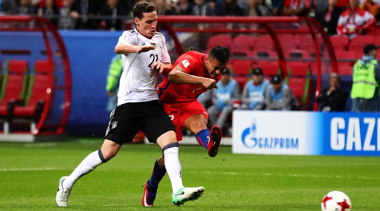 <p>When the Confederations Cup groups were settled, Germany and Chile being put in the same group appeared to make for the most tantalizing matchup in the competition, and the two powers delivered an entertaining bout in Kazan, Russia, with their 1-1 draw.</p><p>The two-time reigning Copa America champion Chileans outlasted Cameroon 2-0 in a hard-fought, VAR-influenced opener. Reigning World Cup champion Germany, meanwhile, edged Australia 3-2 in a game that it controlled but some sloppy moments in the back–especially in goal–allowed for the Aussies to make it interesting.</p><p>Even with a second-choice squad at the Confederations Cup, Jogi Low's side held its own against Alexis Sanchez, Arturo Vidal & Co., battling back from an early deficit to salvage the point.</p><p>Alexis got the action started early, scoring in the sixth minute after high pressure forced Germany into a turnover. Vidal found Sanchez with the splitting ball, and he finished near-post for the goal, which set a new Chilean national record (38).</p><p>Germany nearly answered immediately, but Julian Draxler's long-range blast whizzed over the bar.</p><p>Eduardo Vargas almost doubled Chile's lead in the 20th minute, blasting a right-footed laser off the crossbar after a quick turn and touch.</p><p>Germany found its equalizer in the 41st minute with a lovely piece of build-up play finished off by Lars Stindl. After beating Chile's pressure, Germany broke forward, with Emre Can spraying the ball wide for Jonas Hector. His cross to the goal mouth was met by a sliding Stindl, who scored his second goal of the competition to make it 1-1.</p><p>Alexis nearly seized the lead back for Chile before halftime with a low, deflected blast from long range, but Marc-Andre ter Stegen got down and to his right, swatting away the attempt before it could sneak into the lower left-hand corner.</p><p>The teams exchanged chances in the second half, with Chile coming closest on Alexis's long-range free kick, which narrowly missed the crossbar.</p><p>After Cameroon's draw vs. Australia, the draw means that no team has clinched a berth in the knockout stage just yet. Australia needs a two-goal win over Chile, and Cameroon needs a three-goal win over Germany in order to upset the favorites and advance.</p>