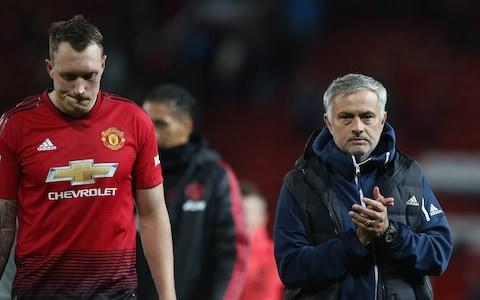 Phil Jones and manager Jose Mourinho trudge off after defeat - Credit: Getty images