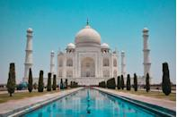 """<p>Perhaps one of the best-known buildings, the Taj Mahal in India is often described as one of the wonders of the world. With its gorgeous ivory-white marble and picturesque <a href=""""https://www.housebeautiful.com/uk/garden/g35612268/buckingham-palace-gardens-royal-garden-book/"""" rel=""""nofollow noopener"""" target=""""_blank"""" data-ylk=""""slk:gardens"""" class=""""link rapid-noclick-resp"""">gardens</a>, we're not at all surprised it made the list. </p>"""