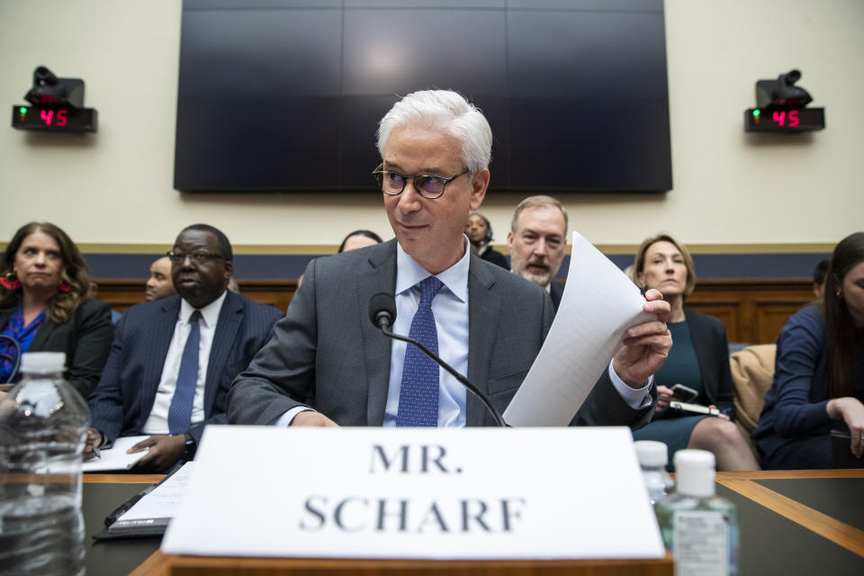 Wells Fargo CEO and President Charles Scharf is seated before he testifies during a hearing of the House Financial Services Committee, on Capitol Hill, Tuesday, March 10, 2020, in Washington. (AP Photo/Alex Brandon)