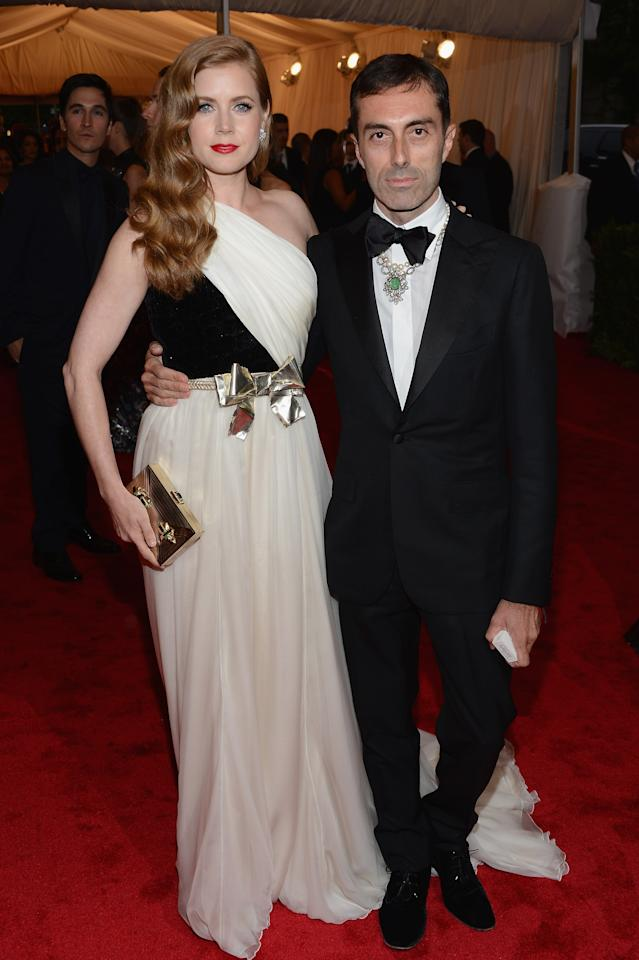 """NEW YORK, NY - MAY 07:  Actress Amy Adams and designer Giambattista Valli attend the """"Schiaparelli And Prada: Impossible Conversations"""" Costume Institute Gala at the Metropolitan Museum of Art on May 7, 2012 in New York City.  (Photo by Dimitrios Kambouris/Getty Images)"""