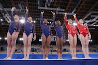 <p>TOKYO, JAPAN - JULY 25: Grace McCullum, Sunisa Lee, Jordan Chiles, Simone Biles, Mykayla Skinner and Jade Carey of Team USA wave as they line up ahead of their floor routines on day two of the Tokyo 2020 Olympic Games at Ariake Gymnastics Centre on July 25, 2021 in Tokyo, Japan. (Photo by Laurence Griffiths/Getty Images)</p>