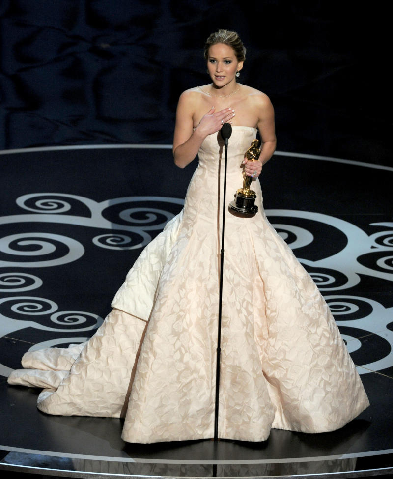 """Jennifer Lawrence accepts the award for best actress in a leading role for """"Silver Linings Playbook"""" during the Oscars at the Dolby Theatre on Sunday, Feb. 24, 2013, in Los Angeles. (Photo by Chris Pizzello/Invision/AP)"""