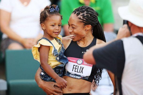 PHOTO: Allyson Felix celebrates with her daughter Camryn after finishing second in the women's 400-meter final at the 2020 U.S. Olympic track and field trials on June 20, 2021 in Eugene, Ore. (Patrick Smith/Getty Images, FILE)