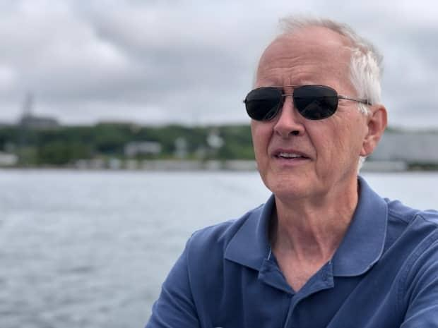 Bob Chaulk, who estimates he's dived in Halifax harbour more than 1,000 times, recently found an anchor that he believes has ties to the Halifax Explosion. (Jon Tattrie/CBC - image credit)