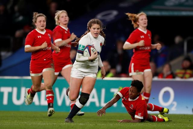 Rugby Union - Women's International - England vs Canada - Twickenham Stadium, London, Britain - November 25, 2017 England's Jess Breach gets past Canada's Sam Alli before she scores her fourth try Action Images via Reuters/Paul Childs
