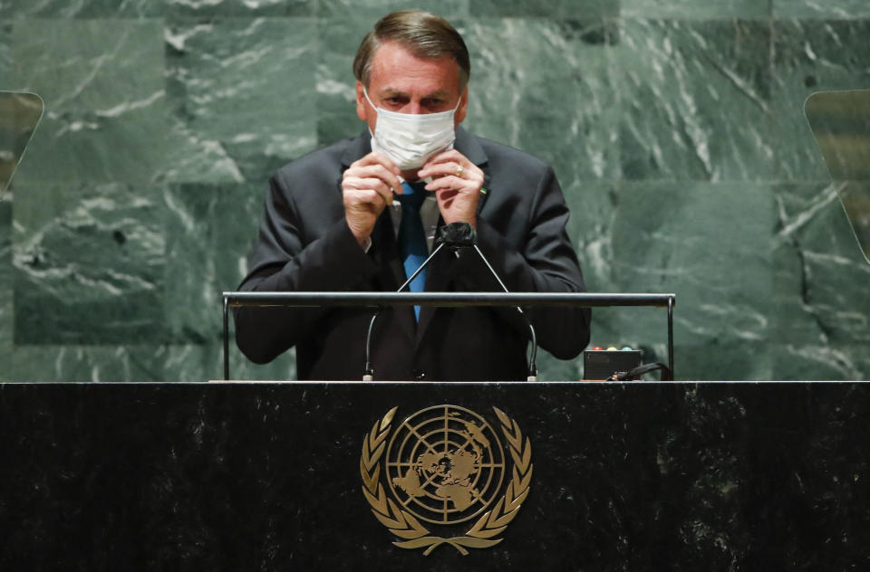 Brazil's President Jair Bolsonaro puts back on a protective facemask due to the coronavirus disease (Covid-19) pandemic after speaking at the 76th Session of the UN General Assembly on September 21, 2021 in New York. - The summit will feature the first speech to the world body by US President Joe Biden, who has described a rising and authoritarian China as the paramount challenge of the 21st century. (Photo by EDUARDO MUNOZ / POOL / AFP) (Photo by EDUARDO MUNOZ/POOL/AFP via Getty Images)