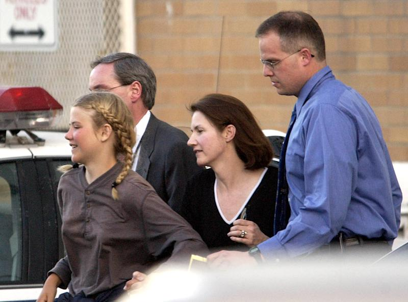 "FILE - In this March 12, 2003, file photo, Elizabeth Smart is rushed into an unmarked van from the Salt Lake City Police department and taken to her home, in Salt Lake City. More than a decade after her kidnapping and rescue grabbed national headlines, Elizabeth Smart is publishing a memoir of her ordeal. The 308 page book, titled ""My Story,"" is being released by St. Martin's Press on Monday, Oct. 7, 2013. (AP Photo/The Salt Lake Tribune, Francisco Kjolseth, File) DESERET NEWS OUT; LOCAL TV OUT; MAGS OUT"