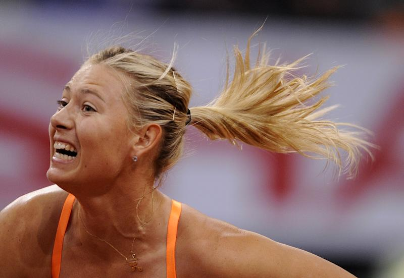 Maria Sharapova from Russia serves to Na Li from China during the final of the WTA tennis Porsche GP in Stuttgart, Germany, Sunday, April 28, 2013. (AP Photo/Daniel Maurer)