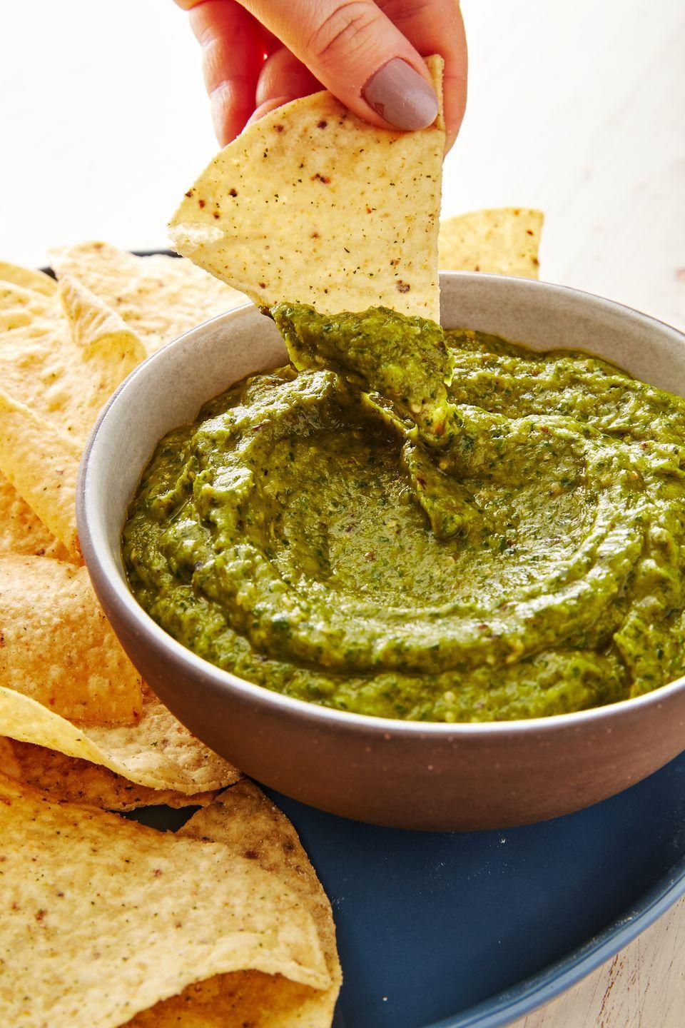 """<p>There are sooo many recipes you can use the leftovers for—if there are any!</p><p>Get the recipe from <a href=""""https://www.delish.com/cooking/recipe-ideas/a30222528/homemade-salsa-verde-recipe/"""" rel=""""nofollow noopener"""" target=""""_blank"""" data-ylk=""""slk:Delish"""" class=""""link rapid-noclick-resp"""">Delish</a>.</p>"""