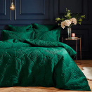 """<p>For dark green bedroom ideas or more decadent inspiration, incorporate texture in your soft furnishing such as curtains or bedding. This creates a richness and feeling of luxury. </p><p>This sumptuous Dunelm set is stunning and is the ideal inspiration if you're looking for emerald green bedroom ideas or furnishings. </p><p><strong>Paoletti Palmeria Emerald Velvet Duvet Cover and Pillowcase Set at Dunelm. <a href=""""https://go.redirectingat.com?id=127X1599956&url=https%3A%2F%2Fwww.dunelm.com%2Fproduct%2Fpalmeria-emerald-velvet-duvet-cover-and-pillowcase-set-1000181778&sref=https%3A%2F%2Fwww.goodhousekeeping.com%2Fuk%2Fhouse-and-home%2Fhome-decorating-ideas%2Fg36449164%2Fgreen-bedroom-ideas%2F"""" rel=""""nofollow noopener"""" target=""""_blank"""" data-ylk=""""slk:Single: £50"""" class=""""link rapid-noclick-resp"""">Single: £50</a>. <a href=""""https://go.redirectingat.com?id=127X1599956&url=https%3A%2F%2Fwww.dunelm.com%2Fproduct%2Fpalmeria-emerald-velvet-duvet-cover-and-pillowcase-set-1000181778&sref=https%3A%2F%2Fwww.goodhousekeeping.com%2Fuk%2Fhouse-and-home%2Fhome-decorating-ideas%2Fg36449164%2Fgreen-bedroom-ideas%2F"""" rel=""""nofollow noopener"""" target=""""_blank"""" data-ylk=""""slk:Double: £60"""" class=""""link rapid-noclick-resp"""">Double: £60</a></strong></p>"""