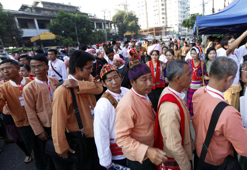 Representatives of Myanmar opposition leader Aung San Suu Kyi's National League for Democracy (NLD) party line up to enter their first ever congress at Royal Rose restaurant in Yangon, Myanmar, Saturday, March. 9, 2013. The NLD is holding an all-party congress to elect its own leadership for the first time in the group's 25-year history - an important step toward making it more reflective of its democratic ideals. It is a sign of how far Myanmar has come with political reform that the gathering is allowed at all. But it's also a test for the NLD, which is working to transform itself from a party of one into a structurally viable political opposition in time for national elections in 2015. (AP Photo/Khin Maung Win)