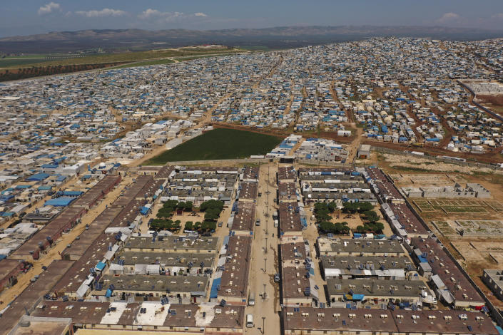FILE - In this April 19, 2020 file photo, shows a large refugee camp on the Syrian side of the border with Turkey, near the town of Atma, in Idlib province, Syria. Millions of Syrians risk losing access to lifesaving aid, including food and COVID-19 vaccines if Russia gets its way at the Security Council by blocking the use of the last remaining cross-border aid corridor into northwestern Syria, an international rights group said Thursday, June 10, 2021. (AP Photo/Ghaith Alsayed, File)