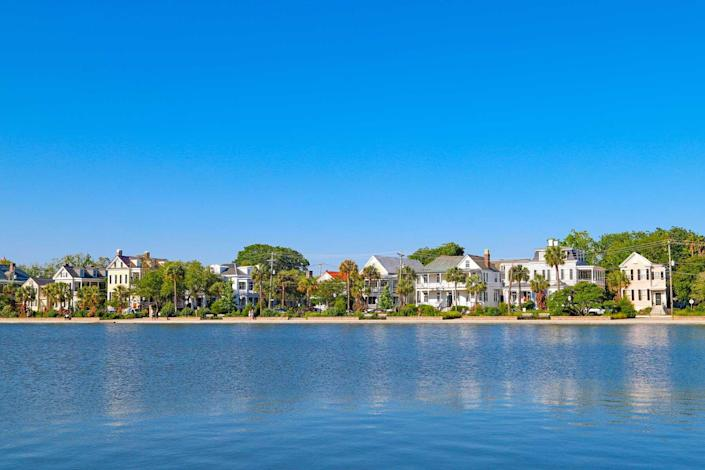 Row of historic homes by Colonial Lake, downtown Charleston, historic district, on a beautiful clear day.