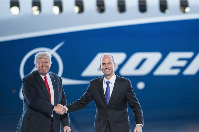 U.S. President Donald Trump, left, is introduced by Boeing's chief executive officer Dennis Muilenburg during the debut event for the Dreamliner 787-10 at Boeing's South Carolina facilities on February 17, 2017 in North Charleston, South Carolina. (Photo: Sean Rayford/Getty Images)