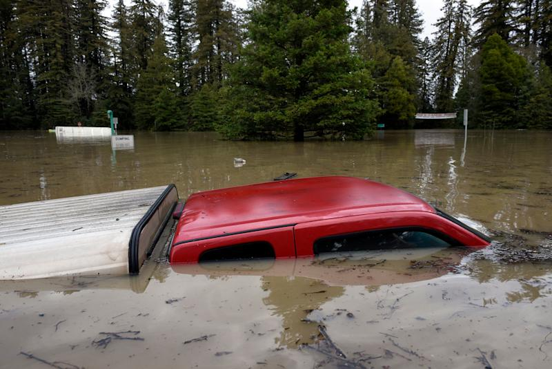 A pickup truck is submerged in flood waters from the Russian River in Forestville, north of San Francisco, Feb. 27, 2019. (Photo: Michael Short/AP)