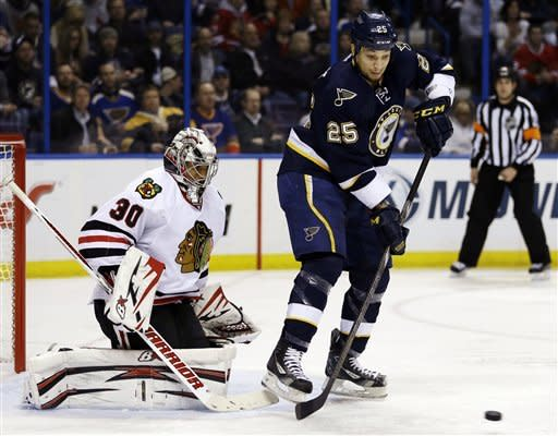 St. Louis Blues' Chris Stewart (25) tries to deflect a puck as Chicago Blackhawks goalie Ray Emery defends during the second period of an NHL hockey game, Thursday, Feb. 28, 2013, in St. Louis. (AP Photo/Jeff Roberson)