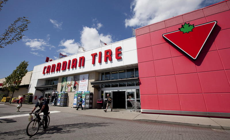 This May 10, 2012 photo shows a Canadian Tire store in North Vancouver, British Columbia. For years, Canadians would cross the border to the U.S. to shop at Target. Exporting its cheap chic there seemed like a no-brainer. But a year after opening more than 100 stores north of the border, Target has found business isn't so easy. Canadian Tire, which operates nearly 500 stores in the country and stocks housewares, barbecue grills and other items besides tires, has increased its marketing and deepened its assortment of home decor and other areas. (AP Photo/The Canadian Press, Jonathan Hayward)