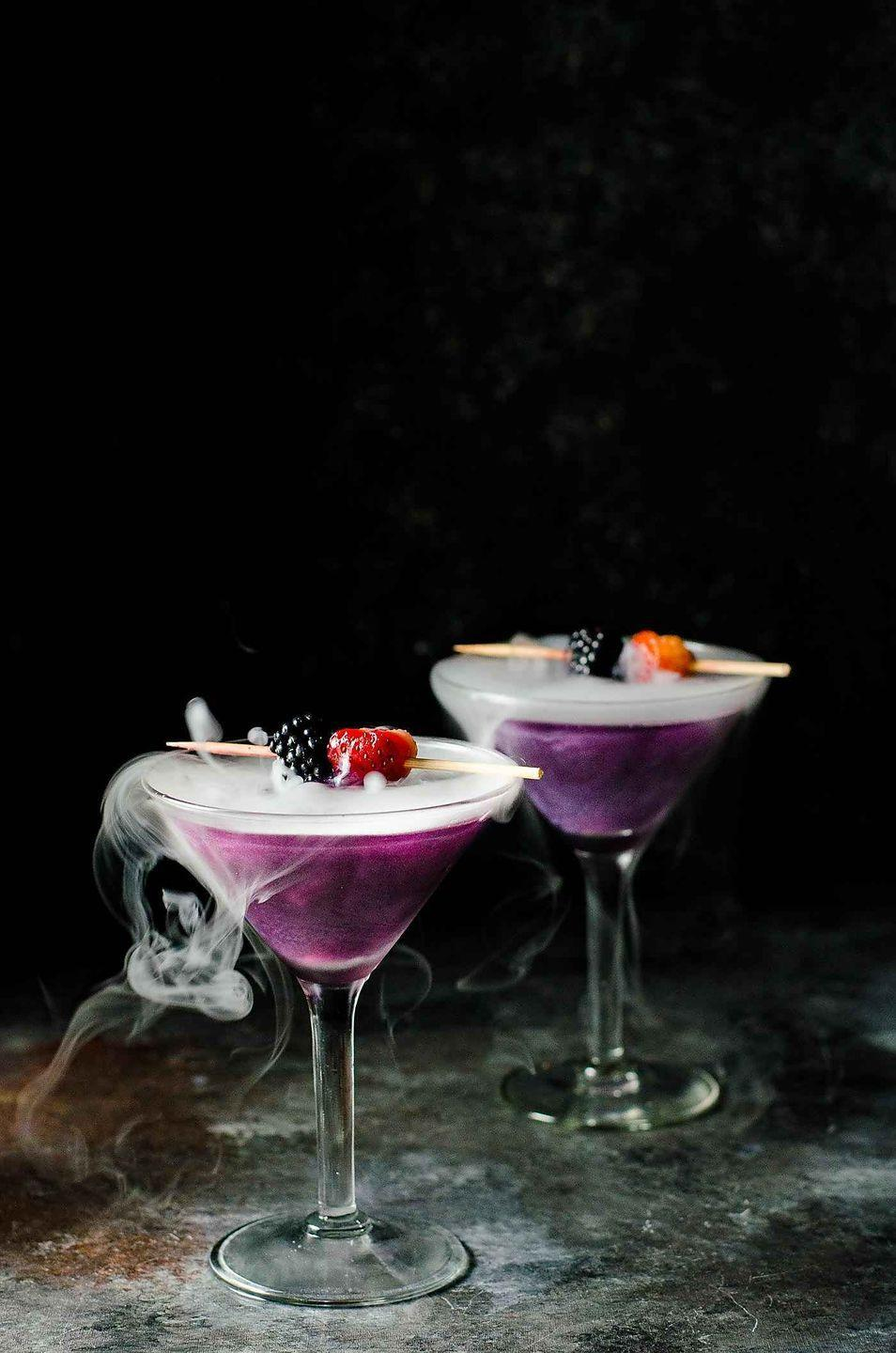 """<p>Pair this magical blackberry martini with a bag of Halloween chocolates and a <a href=""""https://www.thepioneerwoman.com/news-entertainment/g32578311/scary-halloween-movies/"""" rel=""""nofollow noopener"""" target=""""_blank"""" data-ylk=""""slk:scary movie"""" class=""""link rapid-noclick-resp"""">scary movie</a> for a perfect night in. </p><p><strong>Get the recipe at <a href=""""https://www.theflavorbender.com/the-witchs-heart-halloween-cocktail/"""" rel=""""nofollow noopener"""" target=""""_blank"""" data-ylk=""""slk:The Flavor Bender"""" class=""""link rapid-noclick-resp"""">The Flavor Bender</a>. </strong></p><p><a class=""""link rapid-noclick-resp"""" href=""""https://go.redirectingat.com?id=74968X1596630&url=https%3A%2F%2Fwww.walmart.com%2Fsearch%2F%3Fquery%3Dmartini%2Bglasses&sref=https%3A%2F%2Fwww.thepioneerwoman.com%2Fholidays-celebrations%2Fg36982659%2Fhalloween-drink-recipes%2F"""" rel=""""nofollow noopener"""" target=""""_blank"""" data-ylk=""""slk:SHOP MARTINI GLASSES"""">SHOP MARTINI GLASSES</a></p>"""