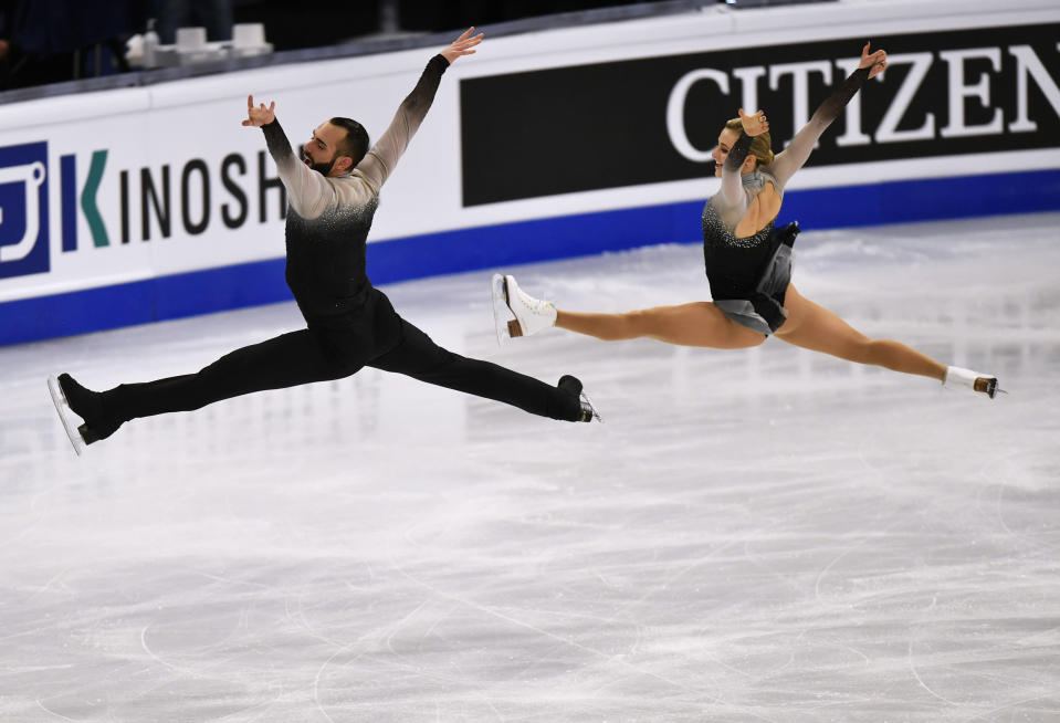 Ashley Cain-Gribble and Timothy LeDuc of the USA perform during the Pairs Free Skating at the Figure Skating World Championships in Stockholm, Sweden, Thursday, March 25, 2021. (AP Photo/Martin Meissner)